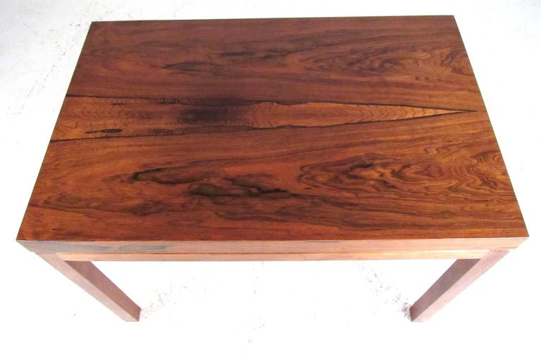 An elegant rectangular rosewood coffee table designed by Milo Baughman for Thayer Coggin, circa 1960s. Very nice vintage condition with original label.