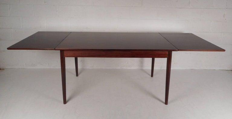 Danish Mid-Century Modern Rosewood Draw Leaf Dining Table by Edmund Jorgensen For Sale