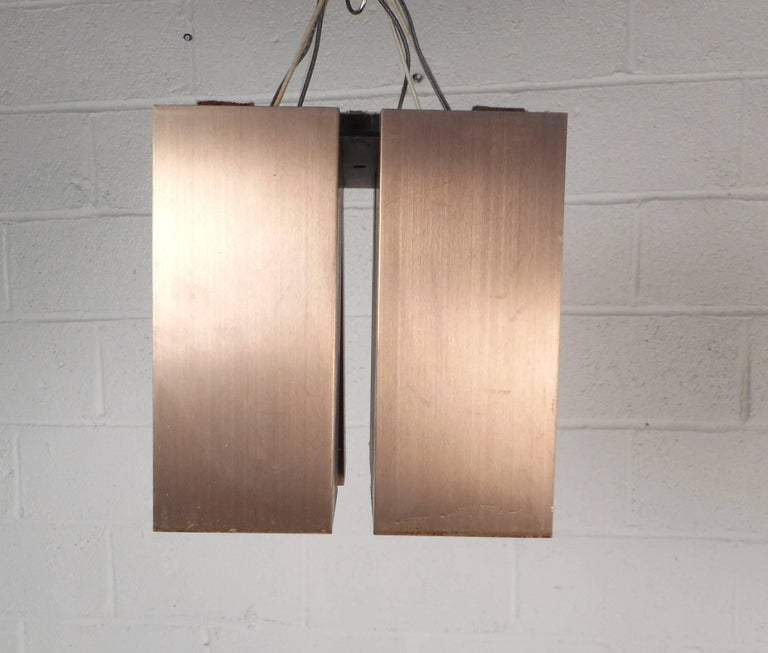Late 20th Century Unique Set of Seven Mid-Century Modern Hanging Brass Chandeliers For Sale