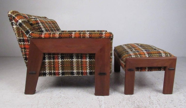 Well constructed and comfortable, this midcentury chair and ottoman with it's walnut frame and houndstooth upholstery will make a strong design statement in any living room or den environment. Please confirm item location (NY or NJ) with dealer.