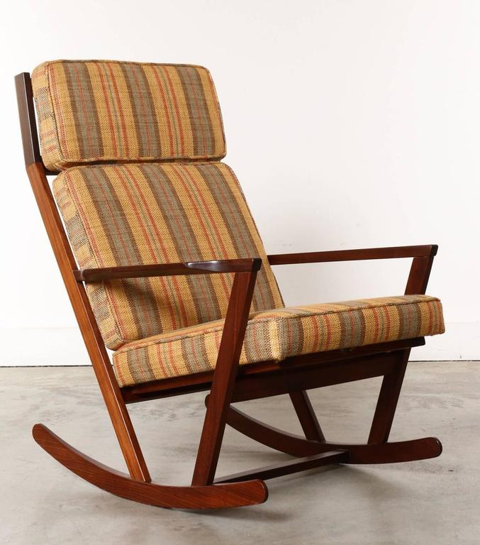 This Danish Modern Wooden Rocking Chair with Cushions Designed by Poul ...