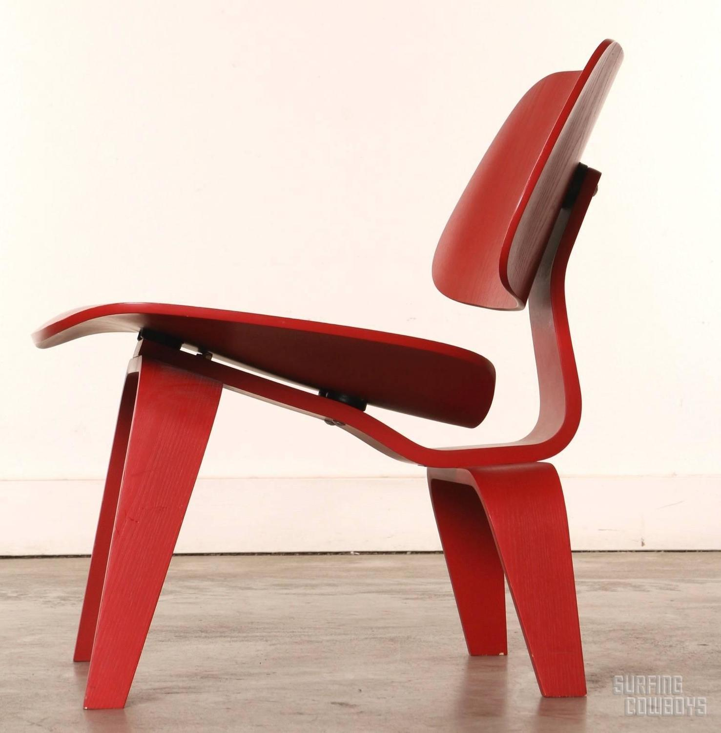 pair of red eames molded plywood lounge chair lcw at 1stdibs