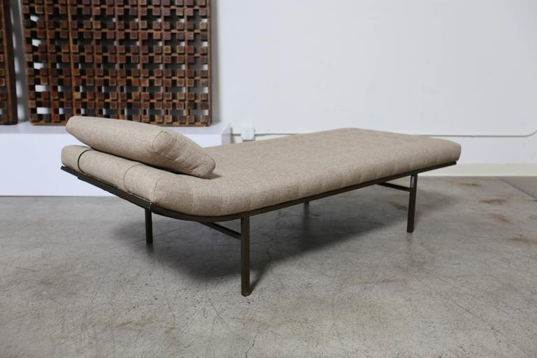 Tufted bronze finished chaise longue by Jules Heumann.