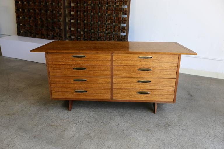"""Origins"" dresser by George Nakashima for Widdicomb. Beautifully figured East Indian Laurel wood with walnut base and brass hardware."