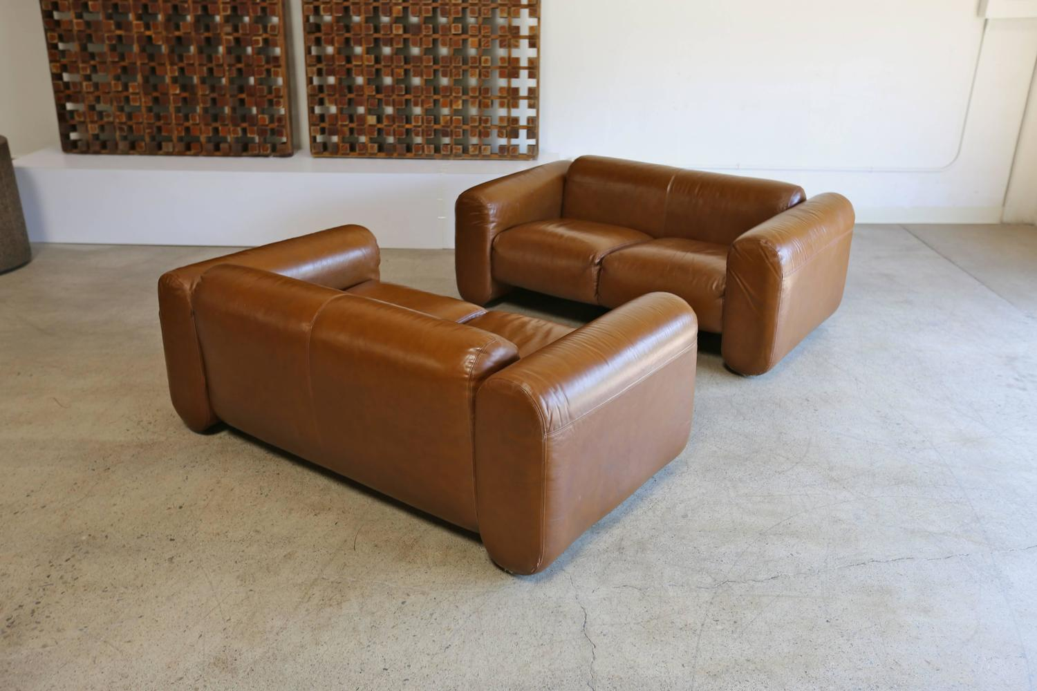 pair of leather sofas by stendig at 1stdibs
