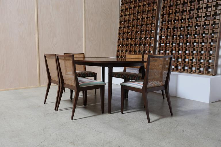 Dining set by Edward Wormley for Dunbar. Dining table with one leaf and six dining chairs.