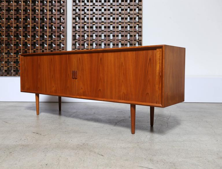 Tambour door credenza by Svend Aage Larsen for Faarup Mobelfabrik. This piece has a finished back.