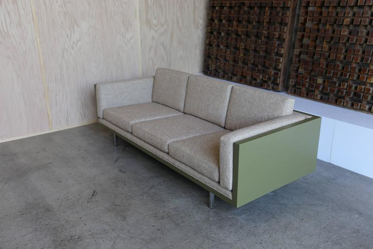 """""""Case"""" sofa by Milo Baughman for Thayer Coggin. The case is wrapped in a green leather."""