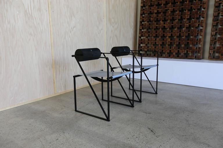 Pair of seconda 602 armchairs by Architect Mario Botta. Each example is signed Alias to the backrest. This pair is in very good original condition.