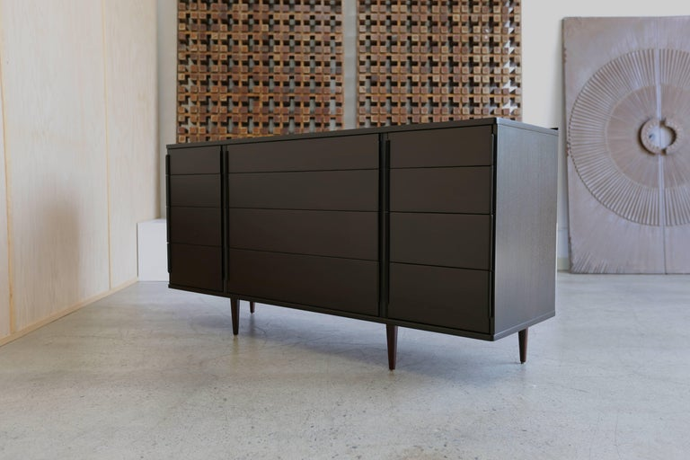 12-drawer dresser With rosewood legs by Edward Wormley for Dunbar. This piece has been professionally restored.