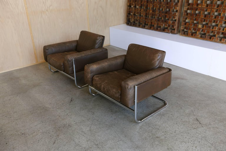"Pair of patinated leather and chrome lounge chairs,  1967.  Nice patina to the original brown leather.  A pair of these can be seen in the iconic Ben Rose House from 1980's Brat-pack movie ""Ferris Buellers day off""."