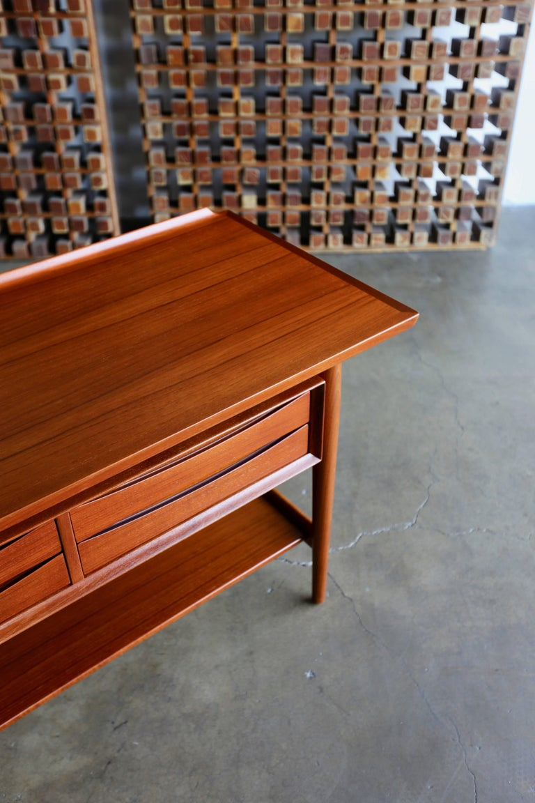 Console table by Arne Vodder for Sibast Mobler. This piece has been professionally restored. Four bow tie drawers with a finished back. This piece retains the original Sibast Mobler label.