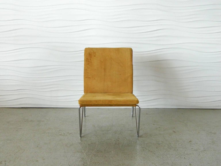 Single Bachelor Chair by Danish designer Verner Panton. The design was created in 1956 and first produced by Fritz Hansen. This example has its original seude material and is complete with both its seat and back cushions.