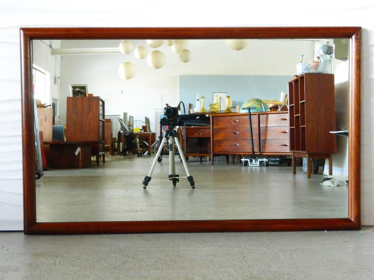 This handsome Mid-Century Modern walnut mirror is by Widdicomb Furniture Co. can be hung horizontally or vertically.