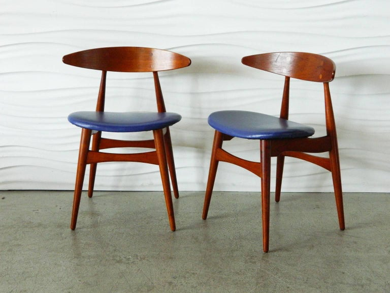 Pair of teak Hans Wegner CH33 chairs with original upholstery.
