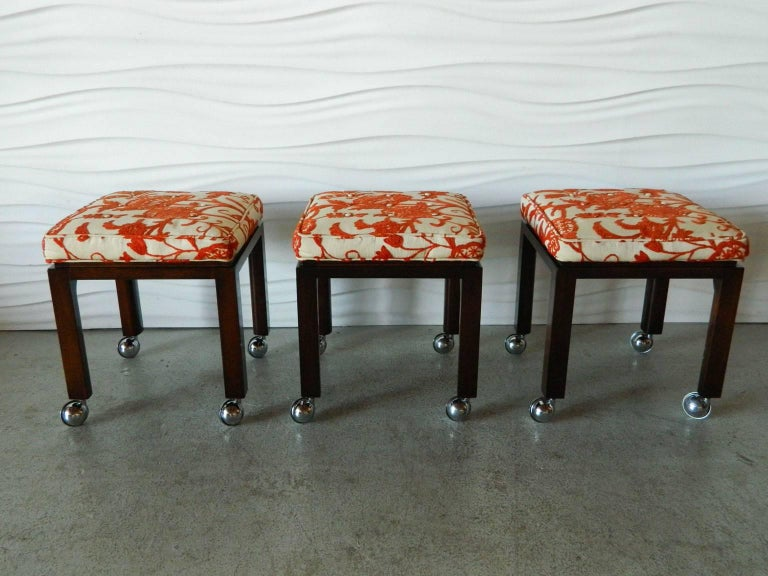 Classic 1960s Harvey Probber stools with original finish, upholstered crewel work seats, and casters.