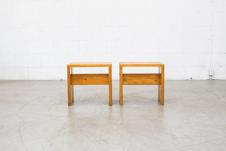 Charlotte Perriand solid pine stools from Les Arcs, France, circa 1968. In good original condition with some wear to surface consistent with age and use. Wood grains vary from set to set. Larger bench version available (S698) set price.