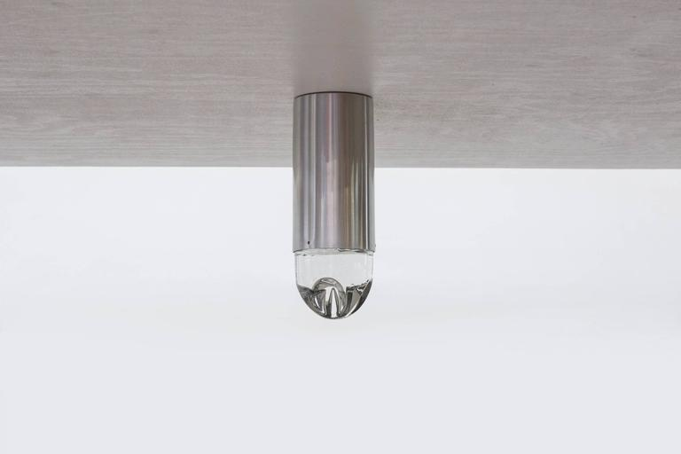 Heavy solid glass caps that screw into long spun aluminum cylinder fixtures in original condition with visible wear consistent with their age and usage. Priced per piece.
