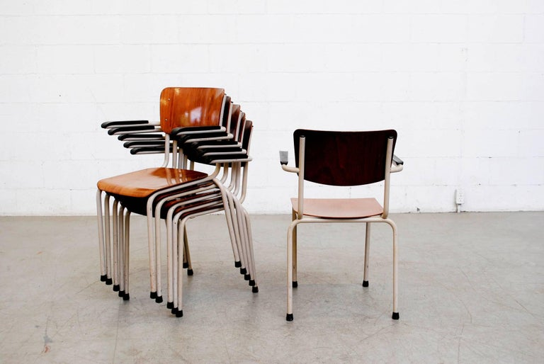 Gispen Stacking Plywood Armchairs with Bakelite Arm Rests In Good Condition For Sale In Los Angeles, CA