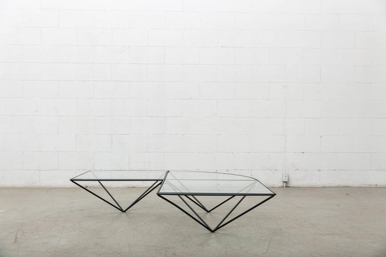 Sweeping curved architectural coffee table with plate glass tops. Available in original condition, visible wear, may have some chipping to the glass. Sold separately, two shown together.