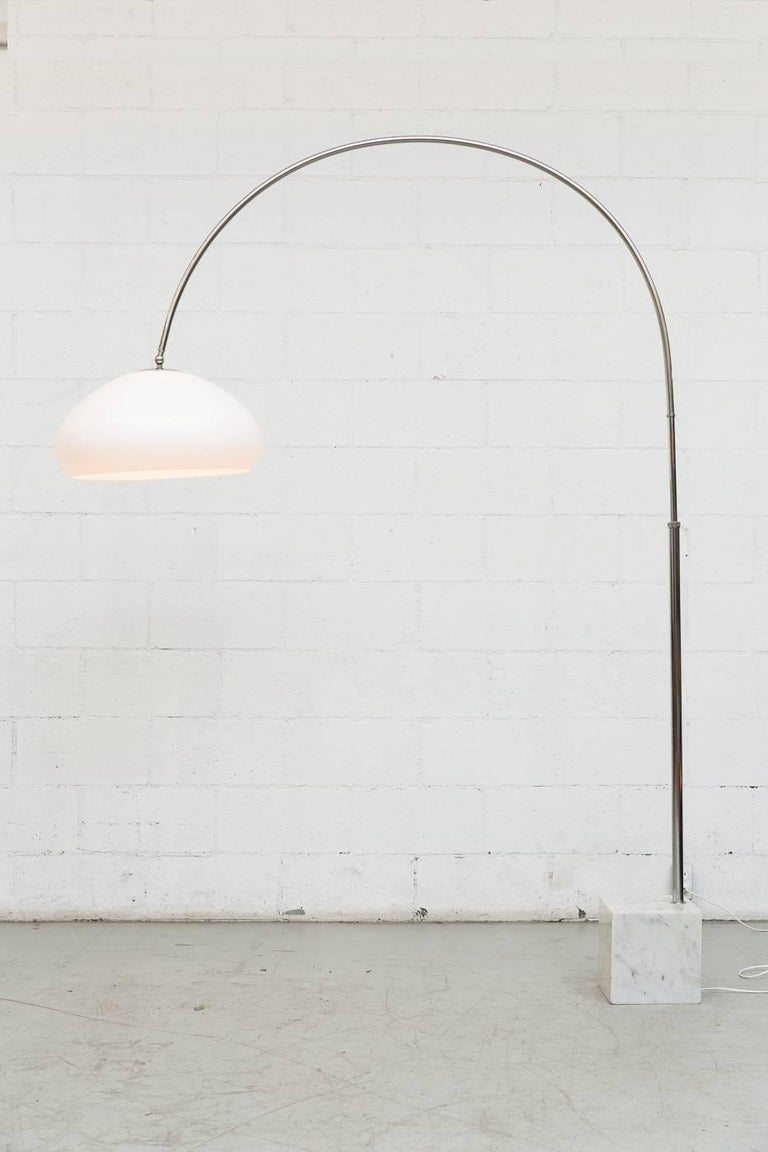 Amazing height adjustable chrome arc floor lamp with 1970s acrylic shade and marble cubic base. In original condition with visible wear consistent with its age and usage. Visible wear to both chrome and marble shows some wear and minor chipping.