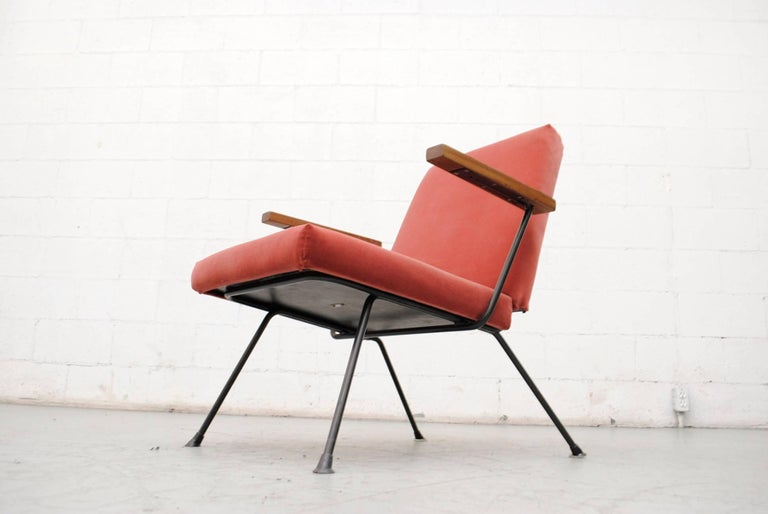 Gorgeous Dutch lounge chair by A.R. Cordemeyer with teak arms. Original black enameled metal frame. Newly upholstered in velvet. Frame shows some signs of wear consistent with its age and usage.