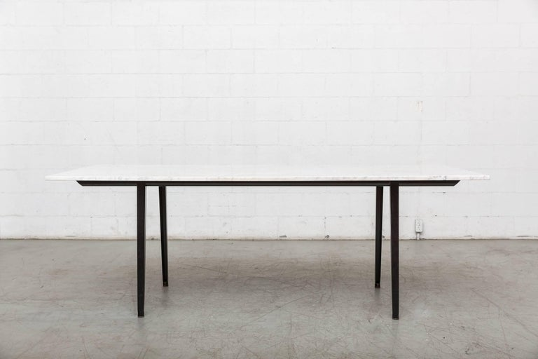 """Black enameled metal Friso Kramer """"Reform"""" table base by Ahrend de Cirkel with large Carrara marble slab top. Black powder coated frame with marble top, both have some signs of wear, top has minimal chipping and fame has minimal scratching. Not"""