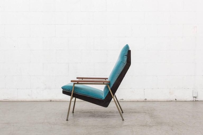 Handsome Robert Parry lounge chair for gelderland with ebony painted teak and square tubular metal frame with new turquoise velvet cushion. Refinished teak arm rests. Frame in original repaired condition.