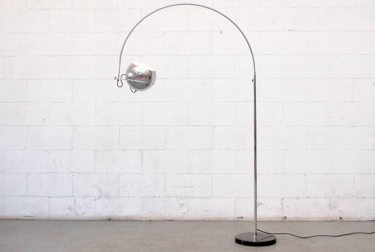 Chrome-plated standing floor lamp with single chrome globe. Adjustable height. Acrylic detail and black enameled metal weighted base. In original condition with some signs of wear, minimal enamel loss and some wear to the chrome.