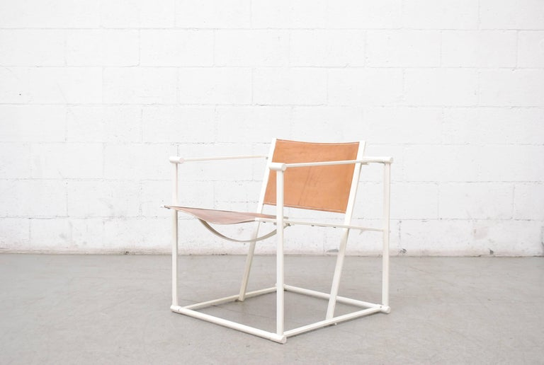 UMS Pastoe FM60, Cubic chair lounge chair, designed in 1980 by Radboud Van Beekum. White Enameled steel frame with natural leather seating. Frame is in original condition with some wear to enamel. Beautiful patina.