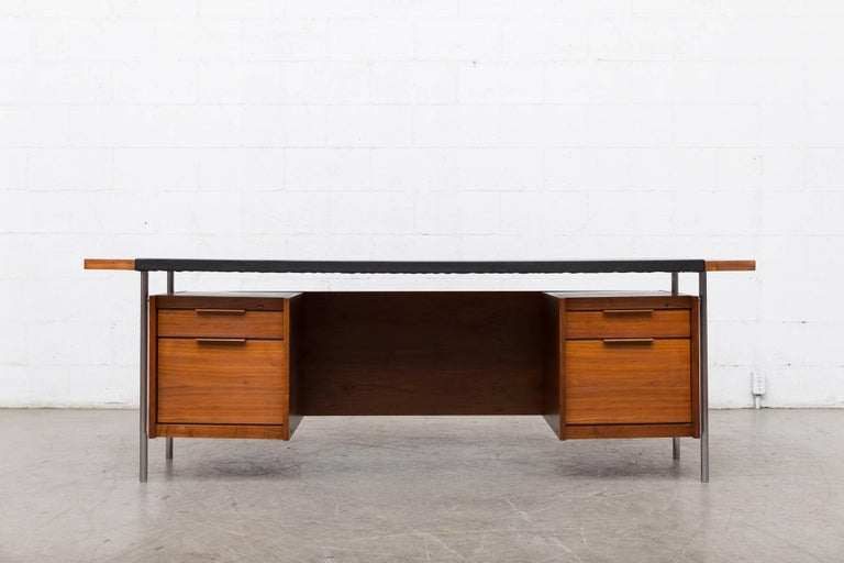 Amazing 1950s Executive desk by Norwegian designer Sven Ivar Dysthe for Dokka Møbler. Teak Body with new black skai top, brushed chrome legs with plexiglass detail. Desk is lightly refinished, some of the original bolts have been replaced. No keys.