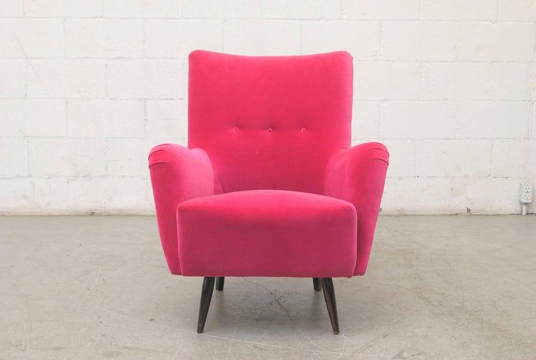 Vintage high back Theo Ruth lounge chair, circa 1956, newly upholstered in hot pink velvet with original dark stained legs.