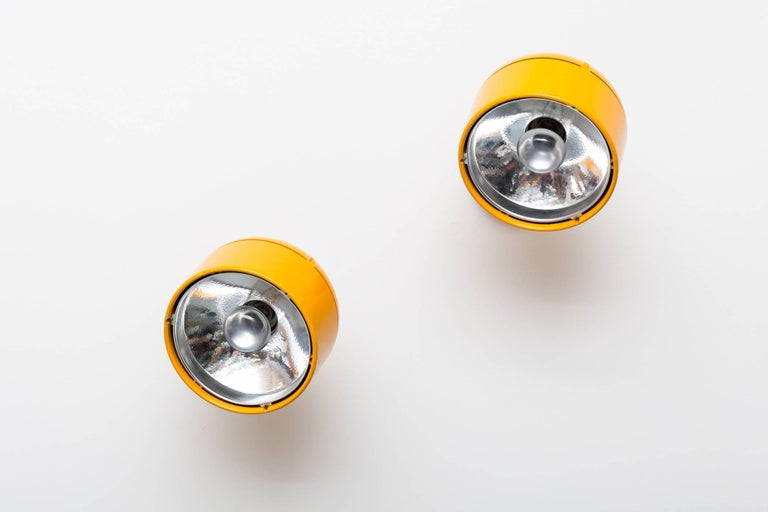 Rare Joe Colombo inspired midcentury yellow enameled metal wall sconces manufactured by Staff in Germany. Chrome reflector inserts. Heavy Swedish construction, heads swivel great original condition. Set price.