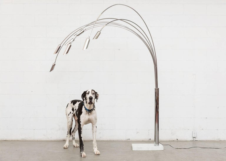 Amazing piece! Midcentury Italian arc lamp with multiple arms. Heavy white marble base. Seven chrome arcs with multi-directional shades. Each arm is movable. Good original condition.   Marble base measurements: 19 x 12 x 2.