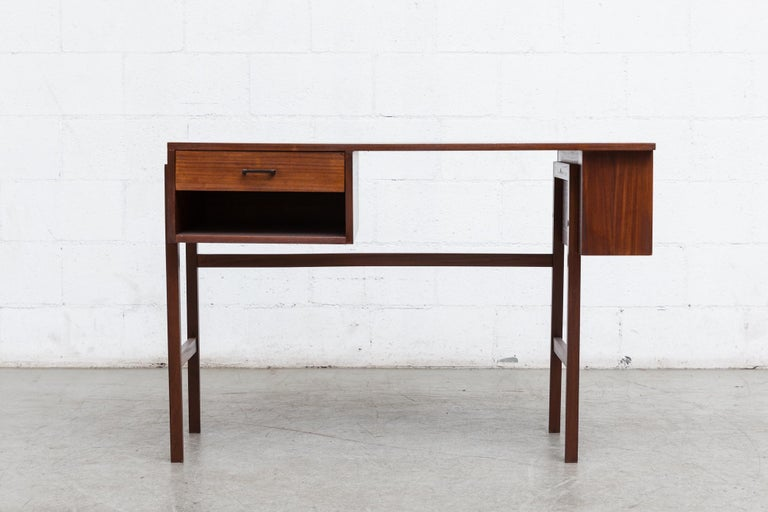 Pierre Paulin inspired midcentury writing desk with single side drawer and cubby on left with side bookcase or right. Lightly refinished. Black acrylic hand pull. Good original condition.