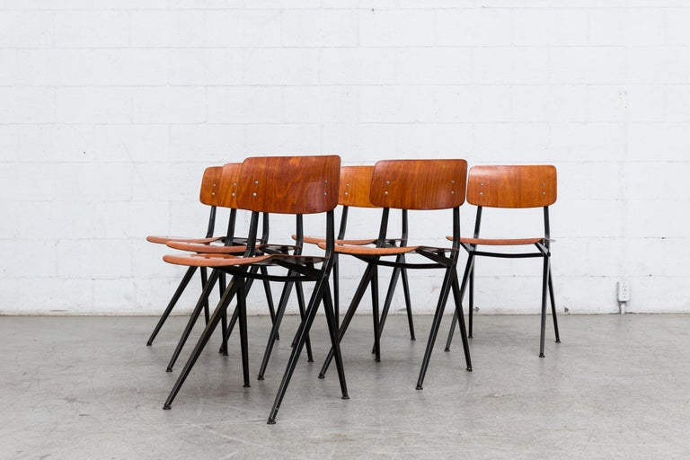 Rare Mid-Century resined teak non-stacking school chairs with Prouve style Compass Legs. These chairs have rich teak toned plywood seats and backs with folded black enameled sheet metal frames. These are in VERY Original Condiiton and Have Visible