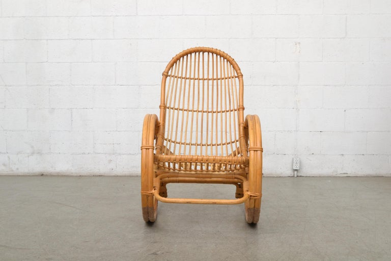 Midcentury bamboo rocking chair inspired by Franco Albini. Great curves. Good original condition. Another similar rocking chair available and listed separately.