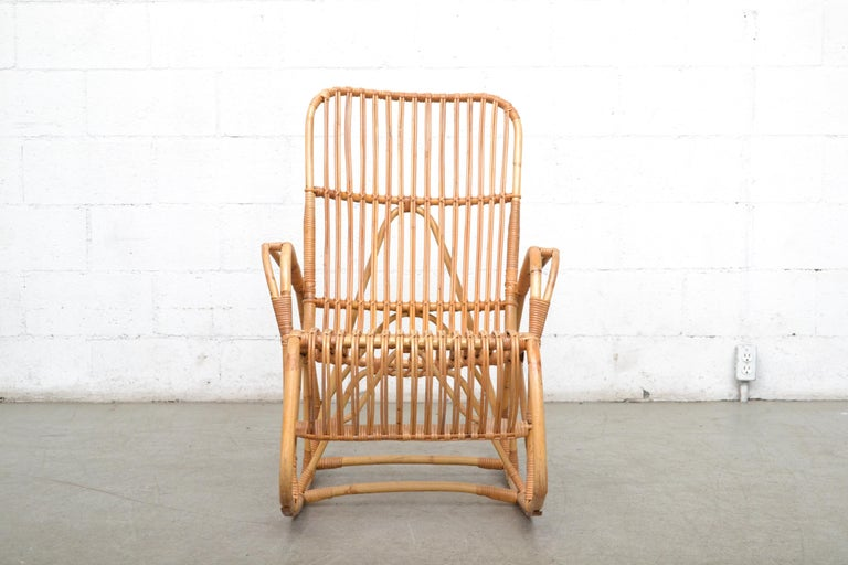 Midcentury high back bamboo rocking chair by Rohe Noordwolde, Holland, 1960s in good original condition with wear consistent with its age and usage.