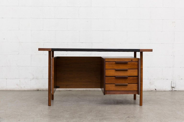 Amazing 1950s desk by Norwegian designer Sven Ivar Dysthe for Dokka Møbler. Teak body with new black skai top, turned wood legs with plexiglass detail. Desk is lightly refinished, no key. Otherwise in very good original condition.