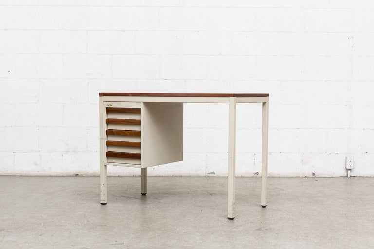 Two available. One with left side drawers, one with right side drawers. Midcentury industrial metal writing desk. Lightly refinished teak top and drawer fronts. Light grey enameled metal frames. Original manufacturers tags.