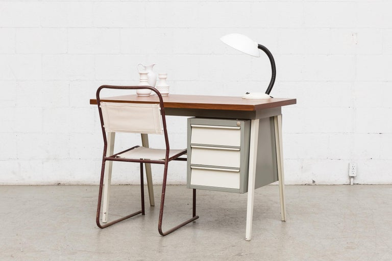 Midcentury industrial metal desk with white and grey enameled metal frame and lightly refinished wood top. Frame in original condition with visible wear. Other similar desks available, but listed separately.