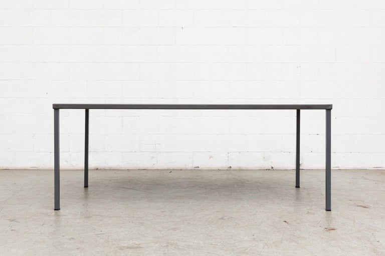 Midcentury industrial dining or conference table. Grey enameled metal frame. Grey/blue linoleum top. Original condition, visible wear.