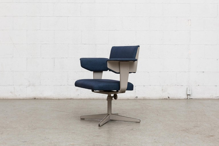 Rare metal framed office chair with adjustable height. Industrial enameled dove grey frame in original condition with visible wear and with some discoloration to enamel. Newly upholstered in indigo blue fabric.
