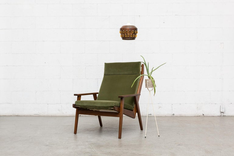 Midcentury Robert Parry lounge chair. Newly upholstered in olive green velvet. Lightly refinished teak frame. Good original condition.