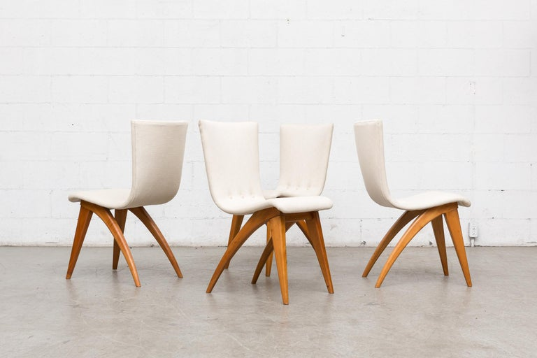 Beautiful Swooping white upholstered dining chairs by VanOs, Culemborg with curved birch legs. Frame in good original condition with new bone white upholstery. Set price.