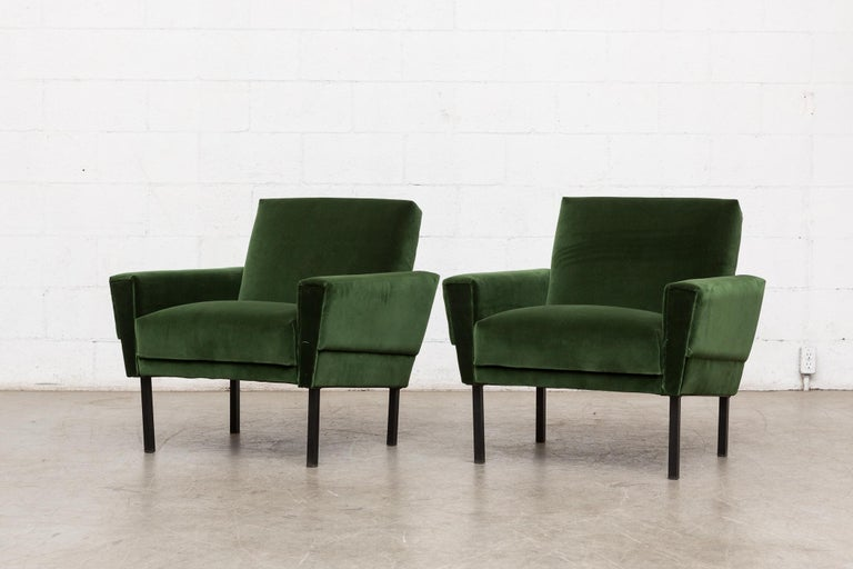 Pair of 1960s Gelderland style club chairs newly upholstered in emerald green velvet with black enameled metal legs. Legs in original condition with some wear. Set price.