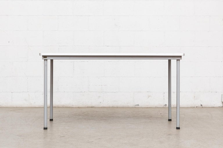 Industrial enameled grey frame with printed formica top. Great dining table, desk or work table from the University of Delft. Original manufacturer metal tag with item number, as pictured.