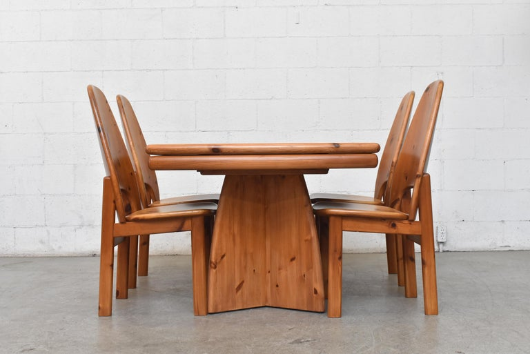 Midcentury Ate Van Apeldoorn style Danish dining set. Manufactured by Glostrup Møbelfabrik design #DK7700. Original manufacturer's sticker, as pictured. Lightly refinished pine. Two leaf extensions nearly double length of table. Each measure 16.5 in