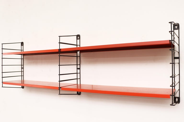 Tomado short two-section industrial shelving unit by Jan Van Der Togt. Orange enameled metal shelves and black enameled metal risers. In original condition with visible wear and some enamel loss.