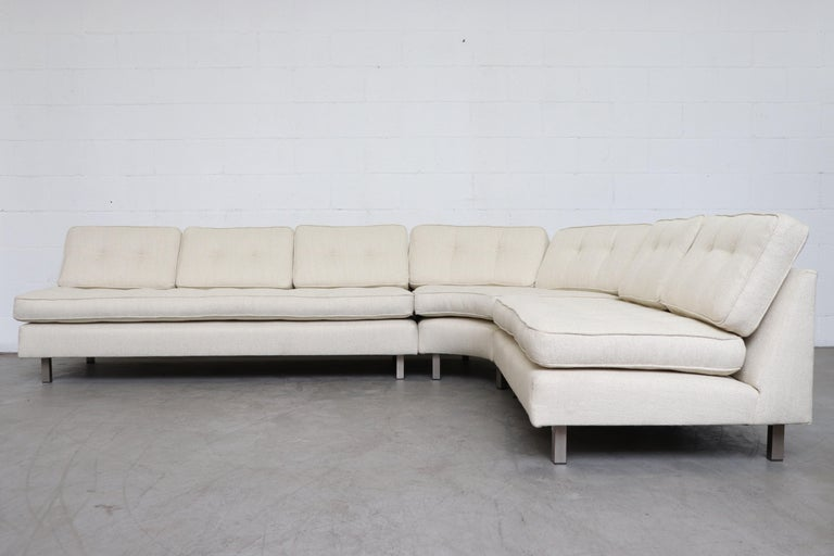 Artifort 3-piece sectional sofa. Newly upholstered in bone white fabric. Frame in original condition with wear consistent with its age and use. A similar rust leather sectional is also available and listed separately (LU9224818214).